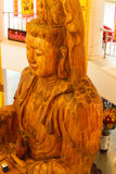 Wooden goddess of mercy (Guan Yin) statue. In asian temple Royalty Free Stock Photo