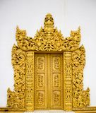 Wooden golden color carving door stock photography