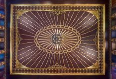 Wooden golden ornate ceiling with design based on sun rays inspired by the old flag of the ottoman empire, Cairo, Egypt Stock Image