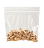 Wooden Golf Tees in a Plastic Bag Royalty Free Stock Images