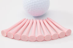 Wooden golf tees on the white table Stock Photo