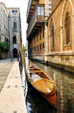 Wooden Gondola in Narrow Venetian Canal, Italy Stock Photo