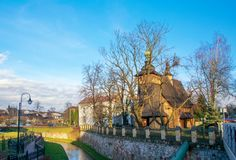 Wooden gothic church of St. Mary in Tarnow, Poland. Wooden gothic church of St. Mary in Tarnow on the coast of small river at sunny day stock photo