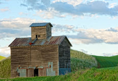 Wooden grain elevator. Old abandoned grain elevator of unique design in the wheat fields of the Palouse Stock Image