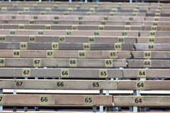 Wooden Grandstand Seats with Numbers Stock Photography