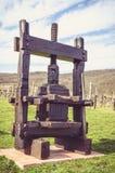 Wooden grape press Royalty Free Stock Image