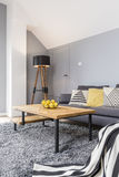 Wooden and gray living room Stock Photos