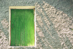 Wooden green an attic door Stock Photo