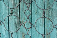 Wooden green background, stained with age and some paint peeling Royalty Free Stock Image