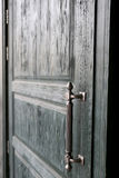Wooden green door with metal handle Stock Photos