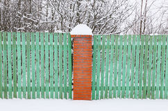 Wooden green fence with brick pillar Stock Image