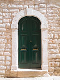 Wooden green frontdoor. Stock Image
