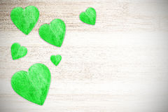 Wooden green hearts on white timbered background. Royalty Free Stock Photography