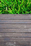 Wooden with green leaves Stock Photography