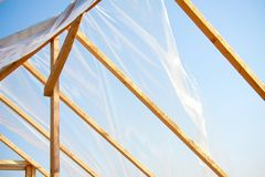 Wooden greenhouse covered with polyethylene Royalty Free Stock Image