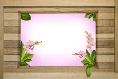 Wooden greeting frame with orchids. Making greetings in the form of a wooden frame made of oak planks inside with sprigs of orchids and space for text Stock Images