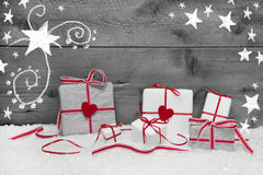 Wooden grey christmas background with snowflakes and presents or stock photos