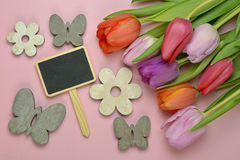 Wooden grey empty copy space background with colorful tulips. Wooden grey empty copy space background with fresh colorful spring tulips. Orange, red,pink and Royalty Free Stock Photos