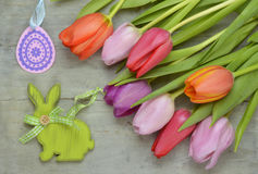 Wooden grey empty copy space Easter background with colorful tulips. Wooden grey empty copy space background with fresh colorful spring tulips. In the corner Stock Images
