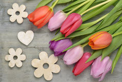 Wooden grey empty copy space Easter background with colorful tulips. Wooden grey empty copy space background with fresh colorful spring tulips. In the corner Royalty Free Stock Photos