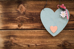 Wooden grey heart with edelweiss Stock Photo