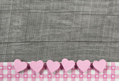 Wooden grey shabby chic background with pink hearts on a white r Stock Photos