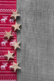 Wooden grey shabby christmas background in red with reindeer. Royalty Free Stock Image