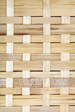 Wooden grid, the background of woven wood. Bamboo wood texture Royalty Free Stock Image