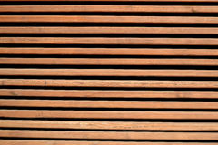 Wooden grid. Instead of a wall in the summer restaurant Stock Photography