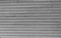 Wooden grooves panel in black and white. Wooden grooves panel closeup in black and white Royalty Free Stock Photos