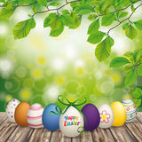 Wooden Ground Easter Eggs Green Nature. Happy easter eggs with ribbon on the wooden table Stock Images