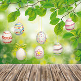 Wooden Ground Hanging Easter Eggs Green Nature. Hanging aster eggs on the wooden background in der nature stock illustration