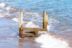 Wooden groyne on beach Stock Photography