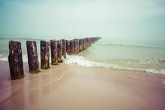 Wooden groynes at the beach of Baltic sea, Poland. Royalty Free Stock Image