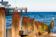 Wooden Groynes and Pier at Southwold Beach, UK Stock Photos