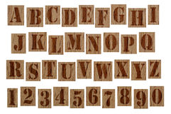 Wooden grunge alphabet letters and numbers Stock Image