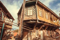 Wooden grunge house with old facade, windows, decor in traditional style built in historical area of Tbilisi, Georgia. Country royalty free stock photography