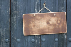 Wooden Grunge Signboard On Planks Wall Background Stock Photo