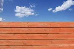 Wooden Grungy Fence and cloudy sky,  Royalty Free Stock Images