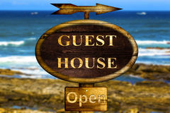 Wooden Guest house sign. Royalty Free Stock Photography