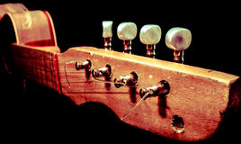 Wooden guitar handle with pegheads. Old wooden guitar handle for stock images Royalty Free Stock Photos