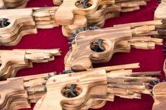 Wooden guns in the market.Thailand. Wooden guns in the market.Thailand Stock Photo