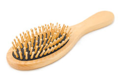 Wooden hair brush. Stock Images