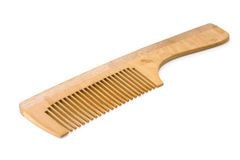 Wooden hairbrush. Some wooden hairbrush on a white background royalty free stock image