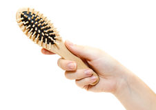 Wooden hairbrush in hand Stock Photos