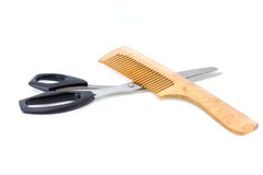 Wooden hairbrush and scissors. Some wooden hairbrush and scissors on a white background stock photography
