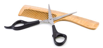 Wooden hairbrush and scissors Stock Photos