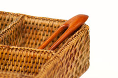 Wooden hairgrip in the braided rattan pannier Stock Image