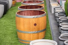 Wooden half barrel for plants and gardening stock photo