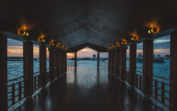 Wooden Hallway Near Water at Dusk Stock Photography